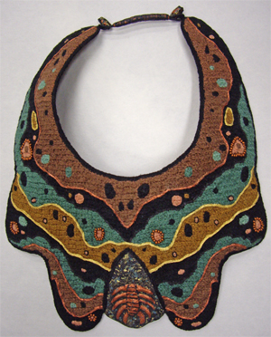 Crocheted, embroidered, beaded neckpiece with papier mache inclusion
